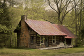 This was an abandoned log cabin I just stumbled across while out exploring the backroads of Tennessee.  I really love the fireplace and the old tin roof.  I'm sure the place had stories it could tell. I'd love to see someone restore this place.