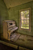 An old upright piano sits in abandoned Young's Chapel in central Georgia. Despite the decay - or perhaps because of it - the place is magical. The stories these walls could tell...