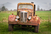 A cool old abandoned truck of the roadside near Tillamook, Oregon.  Notice that the tires still have air in them