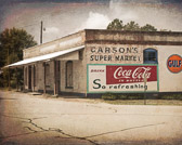 Really cool old market in Farmington, Georgia. The signage on the outside has been restored somewhat, so you can see the logos clearly. I assume the painting was done by the owner of the place who now uses it as an art studio. The place is filled with his paintings and they are quite good. It's not open to the public as far as I know, but we ran into him while photographing and he gave us a quick tour.