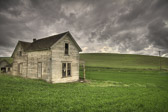 Storms close in quickly out on the plains of western Washington State. This abandoned farmhouse has seen its share of harsh weather, but she still stands proudly in the hills of the Palouse region.