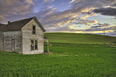 The old abandoned farmhouse  know as the Weber House sits amongst the rolling hills of the Palouse region of Washington State.