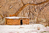 An old abandoned cabin in rural Utah sits underneath a fresh coat of snow.