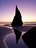 The setting sun behind a lone seastack in Bandon, Oregon. The area is filled with seastacks, but I liked the composition with this one by itself.