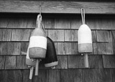 Several bouys haning on the wall of an old lobster shack in coastal Maine.