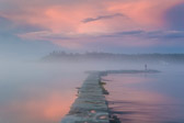 Taken in Lubec, Maine. A huge storm was coming in right around sunset. As the storm approached, it started to get foggy so I grabbed my camera and tripod and walked down to the waterfront. Everything lit up pink and the clouds started to glow which was reflected in the water on either side of the breakwater (or fishing pier?). I though it looked beautiful, and it wasn't until later in my room that I even noticed the couple out on the end of the pier.