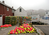 Colorful lobster backets and bouys piled up outside the New Harbor CO-OP in New Harbor, Maine.