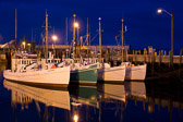 The fishing fleet in North Head Harbour rests in the calm water of the Bay of Fundy.  This is on Grand Manan Island in New Brunswick, Canada.