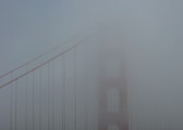 I love the fact that there are no details visible here, but you know immediately what you are loking at. The international orange of the iconic bridge cuts through the thick fog for which the city is also known.