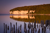 This is in Fayette State Park, in the Upper Peninsula of Michigan. The cliffs in the distance glow as sunset approaches.