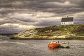 A massive storm approaches the relatively calm waters of Peggy's Cove, Nova Scotia.