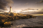 A cloudy sunset at Peggy's Cove Lighthouse