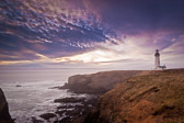 Fog creeps in right before sunset at the Yaquina Head Lighthouse in coastal Oregon.