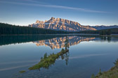 Early morning reflections of Mount Rundle in Two Jack Lake. Taken in Banff National Park, Canada.