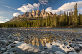 Castle Mountain reflected in the Bow River just before sunset. Banff National Park, Canada.