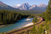An eastbound train twists through Morant's Curve in the Canadian Rockies.