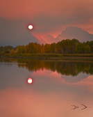 This unusual haze over Oxbow Bend in Grand Teton National Park is due to massive wildfires in neighboring Yellowstone National Park.