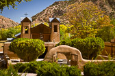 El Santuario de Chimayó, a famous Catholic Church known worldwide for its healing powers, sits nestled inbetween the surrounding hillsides and early autumn colors.