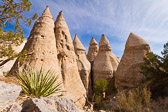 """This National Monument rests on the southeastern flanks of the Jemez Mountains, southwest of Santa Fe. Scores of gravel, ash and sand """"tent rocks,"""" also known as """"hoodoos,"""" fill the landscape.  While fairly uniform in shape, the tent rock formations vary in height from a few feet to 90 feet."""