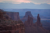 This is in Canyonlands National Park, Utah. Taken through Mesa Arch before the sun came up, you can see the arch know as Washing Woman in the middle ground and the snow-covered La Sal Mountains behind.  This was about five minutes before an amazing sunrise.